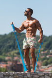 Biceps Exercise Using Resistance Bands Royalty Free Stock Image