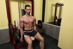 Biceps Exercises On A Machine Royalty Free Stock Photo