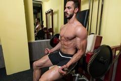 Biceps Exercises On A Machine Stock Photos