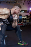 Biceps in gym Royalty Free Stock Image