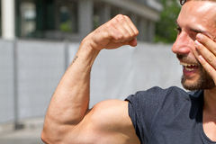 Biceps of a man Stock Photography