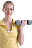 Biceps training. Pretty girl with dumbbells standing and training her biceps Royalty Free Stock Photography