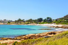 Sandy beach and shallow water - Bicheno. Bicheno on the beautiful East Coast, north of the Freycinet Peninsula, is a popular family seaside holiday town Royalty Free Stock Photos