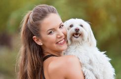 Bichon bolognese dog with beautiful in the park. Bichon bolognese dog with beautiful owner in the park stock photography