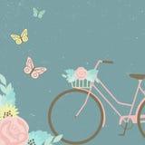 Bici con el ramo floral y las mariposas Imágenes de archivo libres de regalías
