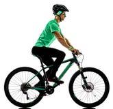 Bici de montaña del muchacho de Tenager bking sombras aisladas Fotos de archivo libres de regalías