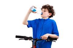 Agua potable del ciclista aislada en el fondo blanco Fotografía de archivo libre de regalías