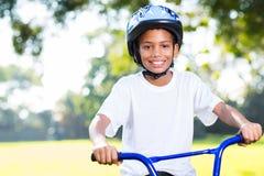 Bici di guida del ragazzo Fotografia Stock
