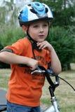 Bici di guida del ragazzo Fotografie Stock