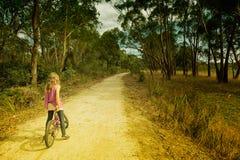 Bici di guida della ragazza Immagine Stock Libera da Diritti