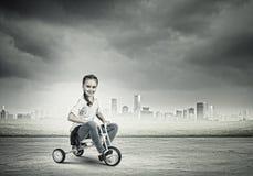 Bici di guida della ragazza Fotografia Stock