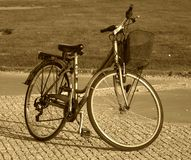 Bicicle. Old fashioned bicycle in sepia Stock Photography