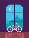 Bicicleta al lado de la ventana Foto de archivo