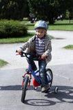 Bicicleta da equitação da criança Imagens de Stock Royalty Free