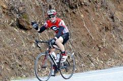 Bicicleta da equitação do homem em uma raça Imagens de Stock