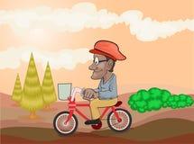 bicicleta da equitação do homem idoso na tarde Fotografia de Stock Royalty Free