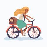 Bicicleta da equitação da jovem mulher com seu animal de estimação Foto de Stock