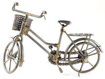 Bicicleta del juguete con el camino aislado Foto de archivo libre de regalías