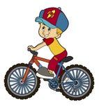 Bicicleta del montar a caballo del niño de la historieta Foto de archivo libre de regalías