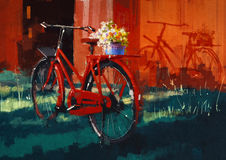 Bicicleta del vintage con el cubo lleno de flores Fotografía de archivo
