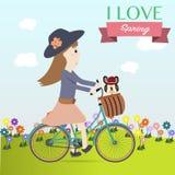 Bicicleta do ciclismo da menina no tempo de mola ilustração do vetor