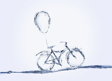 Bicicleta e balão da água Imagens de Stock