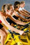 Bicicleta en la gimnasia Imágenes de archivo libres de regalías