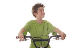Bicicleta joven feliz del montar a caballo del muchacho Fotos de archivo libres de regalías