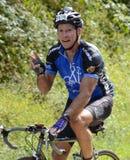 Bicicleta Rider Signaling During un evento Imágenes de archivo libres de regalías
