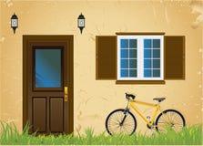 Bicicleta y casa vieja Imágenes de archivo libres de regalías