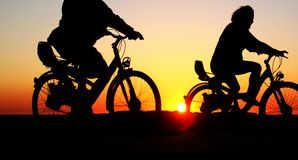 Bicicletas no por do sol Foto de Stock Royalty Free