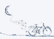Bicicletta dell'acqua, ombrello e traccia della stella Fotografie Stock