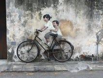 Bicicletta della sorella del fratello della Malesia Pulau Pinang George City Fotografia Stock