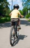 Bicicletta di guida del bambino Fotografia Stock Libera da Diritti