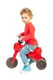 Bicicletta di guida del ragazzo del bambino Fotografie Stock