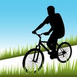 Bicicletta di guida dell'uomo Fotografie Stock Libere da Diritti