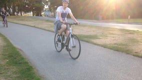 Bicicletta di guida della gente Immagine Stock Libera da Diritti