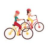 Bicicletta di guida della giovane donna, ciclante insieme a sua figlia adolescente Immagine Stock