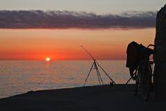 Bicicletta ed asta di pesca Fotografia Stock