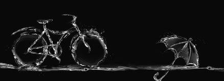 Bicicletta ed ombrello neri dell'acqua Fotografie Stock Libere da Diritti