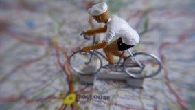 Bicicletta su una mappa Fotografie Stock Libere da Diritti