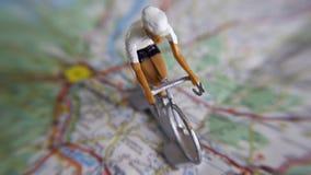 Bicicletta su una mappa Fotografia Stock