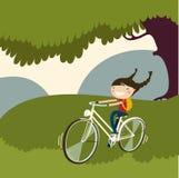 Bicicletta sveglia dell'anello della ragazza Fotografia Stock Libera da Diritti