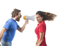 Bickering couple. Concept of couples fight with screaming on the megaphone royalty free stock image