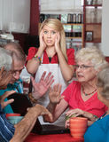 Bickering Seniors and Young Waitress Royalty Free Stock Photos