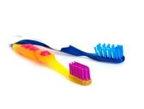 bicolor изолированные toothbrushs Стоковое Изображение RF
