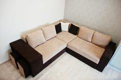 Bicolor cofee corner sofa bed at light room Royalty Free Stock Image