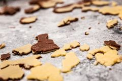 Bicolor cookie dough crumbs or leftovers on grey background royalty free stock photography