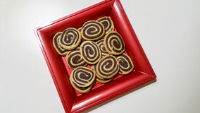 Bicolor cookies. On a red tray Stock Image