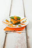 Bicolor Cream Gnocchi Timbale. Portion of pumpkin gnocchi timbale with bicolor sauce: orange, made with pumpkin and green, made with chard, vertical composition Stock Image